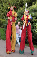stiltwalking jesters
